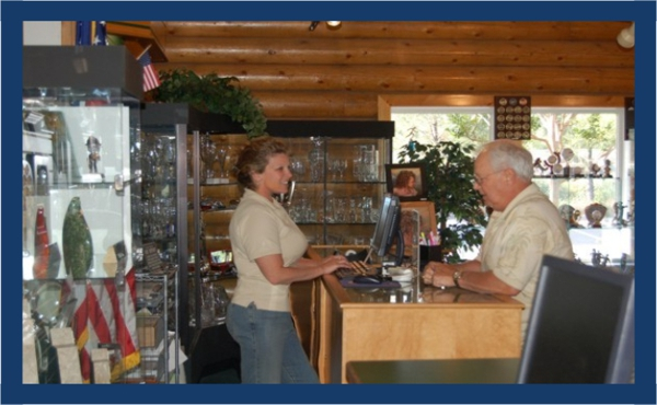 Kami, from Arnolds for Awards in Shingle Springs, California assists a customers at the counter using BizWizard Order Manager™