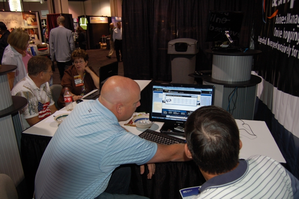 NBM Show in Long Beach, California 2010 Niels Norby giving hands on demonstration of BizWizard Order Management Software for Awards and Trophy Businesses to a prospective customer