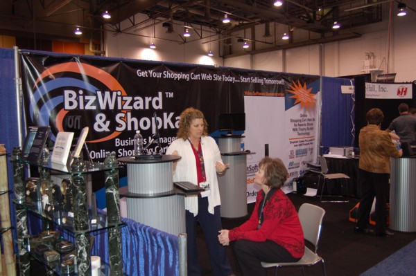 Sherry Grabil and Kami Arnold discuss BizWizard Order Manager™ and BizWizard ShopKart™ awards and trophy shopping cart software at the 2010 awards and trophy international tradeshow